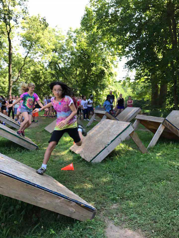 Kids participate in obstacle course